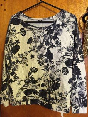 schwarz- weißes Sweatshirt mit Blumen-Aufdruck von Pimkie