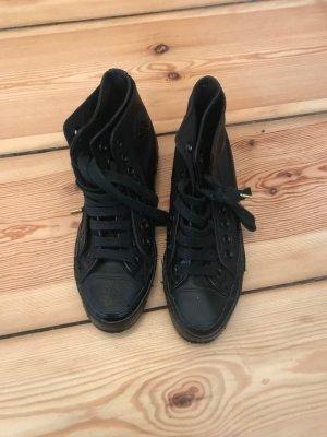 Schwarze All Star Converse Sneakers