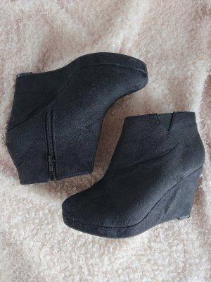 Schwarze Ankleboots