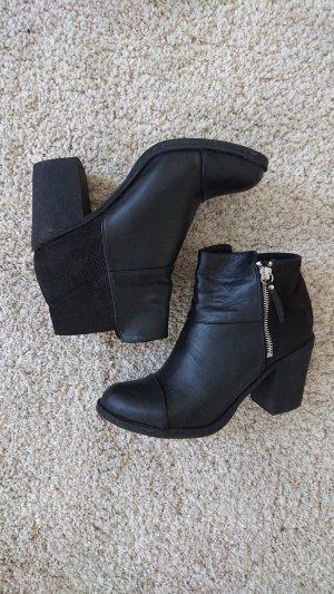 Schwarze Ankleboots Lederimitat