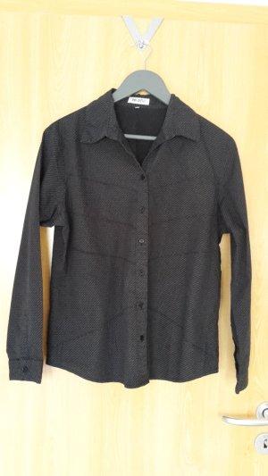 Schwarze Bluse mit CK Aufschrift