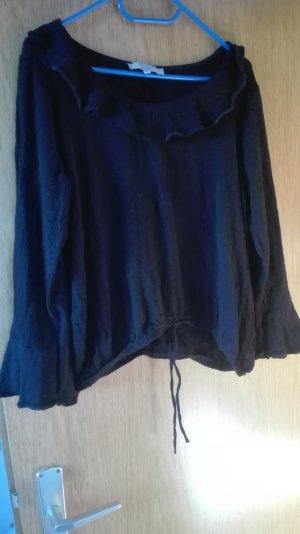 schwarze Bluse mit fallen