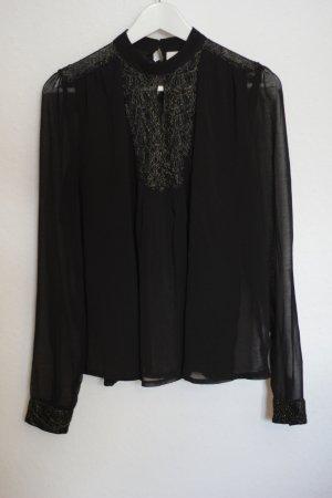 Schwarze Bluse mit Goldverzierungen