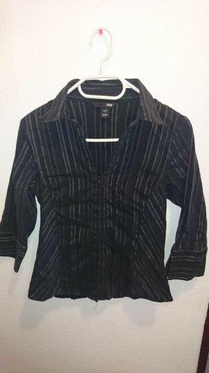 Schwarze Bluse mit Hakenverschluss