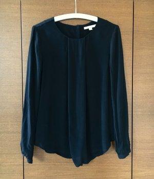 Schwarze Bluse mit Knopfleiste im Rücken