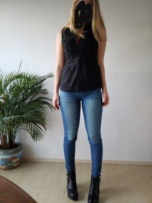 schwarze Bluse mit Kurzarm und Schleife zum binden hinten
