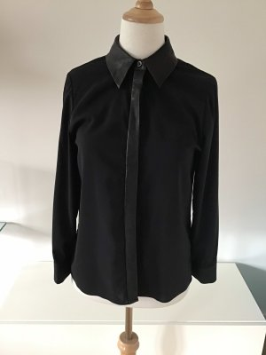 Alice + Olivia Blusa in pelle nero