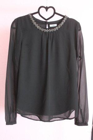 Schwarze Bluse mit Perlen am Kopfausschnitt