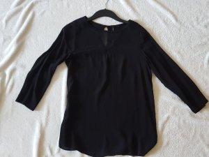 schwarze Bluse mit raffiniertem transparenten V-Ausschnitt