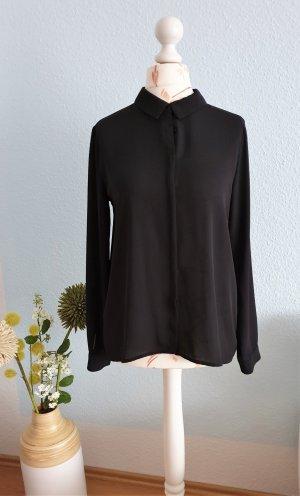schwarze Bluse mit Schleife am Rücken von Zara