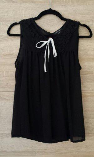 schwarze Bluse mit Schleife