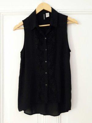 Schwarze Bluse mit Spitze