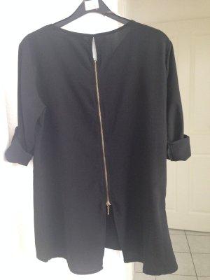 Schwarze Bluse . Mit verstellbare Knöpf Ärmel mit goldene Reißverschluss