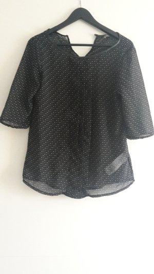 Schwarze Bluse mit weissem Pünktchenmuster