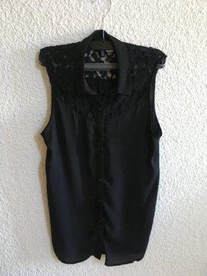 Schwarze Bluse ohne Ärmel