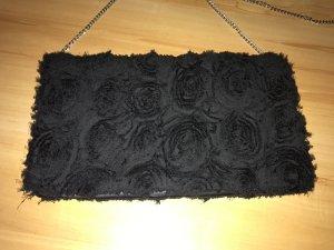 Schwarze Clutch/Umhängetasche mit Blumen