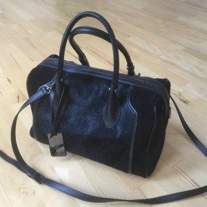 Schwarze Cocchinelle Handtasche aus Fell und Wildleder