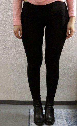 Schwarze elastische Leggings