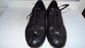 Schwarze Glattleder Puma Sneakers