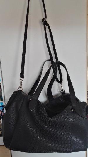 Schwarze Handtasche .