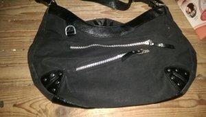 schwarze Handtasche ....
