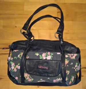 Schwarze Handtasche mit Blumenmuster