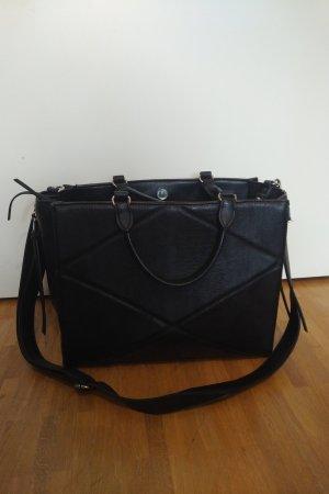 Schwarze Handtasche mit symetric Muster