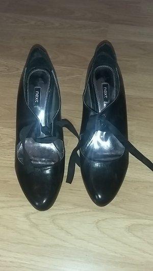 Schwarze High Heels mit Schleifen