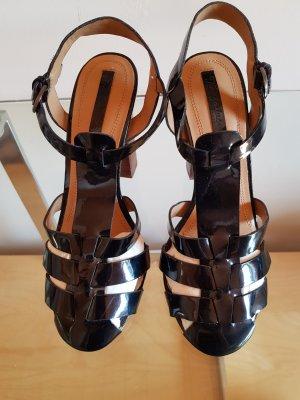 schwarze hohe Sandalen