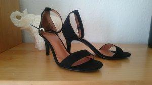 schwarze hohe Schuhe Pumps
