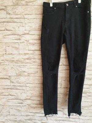 Schwarze Jeans Löcher Skater