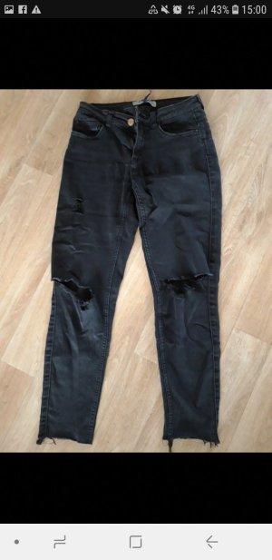 Schwarze Jeans mit Cutouts