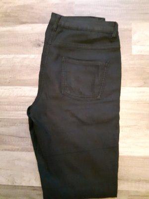 schwarze Jeans mit goldenen Reißverschlüssen