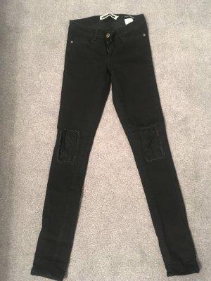 Schwarze Jeans mit Spitzeneinsatz am Knie Gr. 24/32