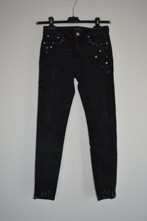 """Schwarze Jeanshose mit """"Piercings"""" Gr.34 Zara"""