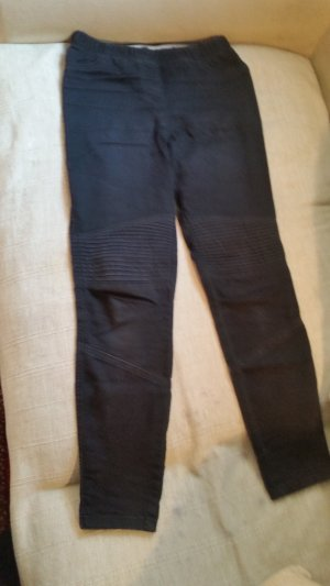schwarze Jeggings mit Applikationen
