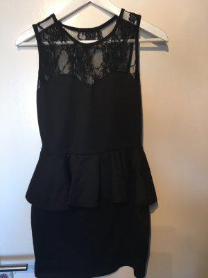 Schwarze Kleid von Nelly