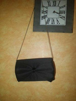 schwarze kleine Handtasche