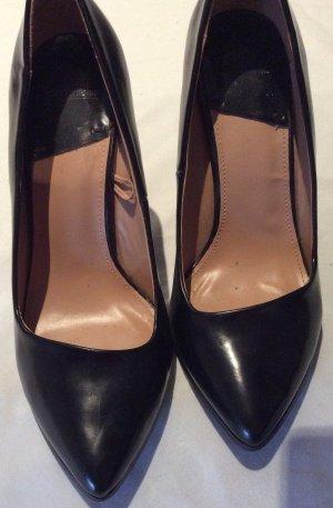 Schwarze Lack Stilettos