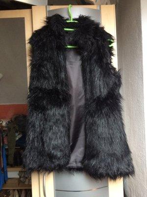 Schwarze lange Fellweste