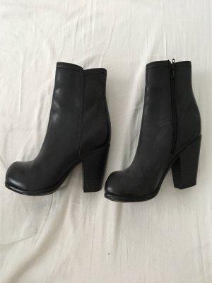 Schwarze Leder Ankleboots