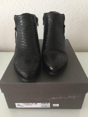 Schwarze Leder Booties mit Krokoprägung