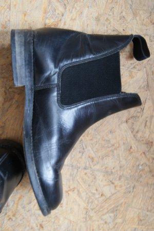 Schwarze Leder-Reitstiefel