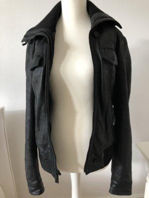 Schwarze Lederjacke mit hohen Strickkragen, oversize, retro