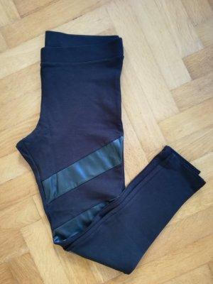 Schwarze Leggings mit Fake Leder Details in Größe L