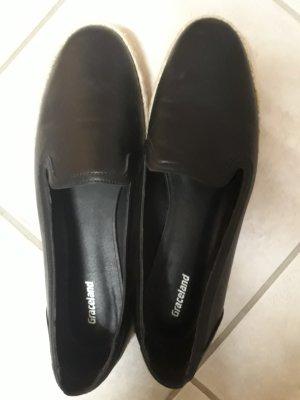 schwarze Loafer mit Bastsohle