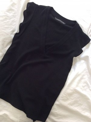 Schwarze lockerfallende Kurzarm-Bluse