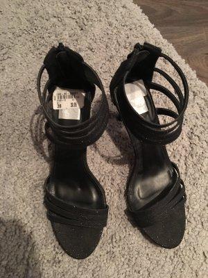 Schwarze mit Glitzer Sandaletten