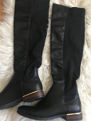 Botas sobre la rodilla negro-color oro