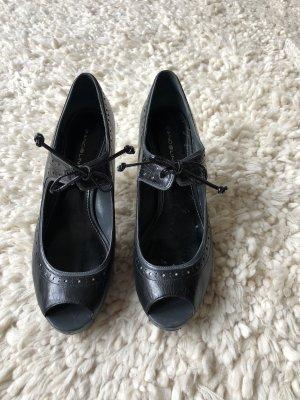 Schwarze Peeptoe High Heels aus Leder